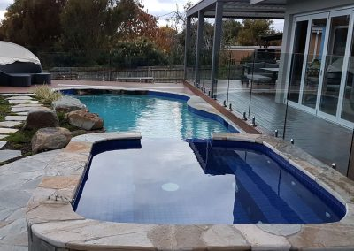 swimming pool with natural stone and landscape